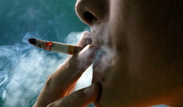 Nausea from tobacco smoke